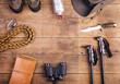 Zdjęcia na płótnie, fototapety, obrazy : Equipment for hiking on a wooden floor background