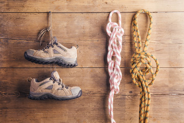 Things for hiking hang on a wooden fence