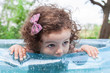 Baby girl in inflatable pool