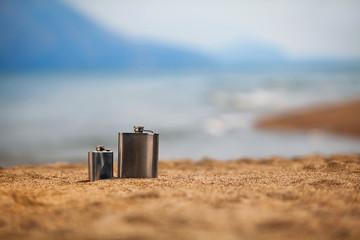 Flasks on beach