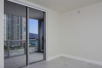 Unfurnished bedroom with a balcony view