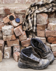 Shoes and clothing near the brick wall builder
