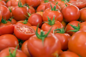 red tomatoes on display in the city bazaar