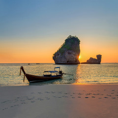 Traditional thai longtail boat at sunset Nui Bay Beach, Thailand