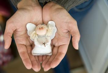 little angel in her hands