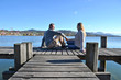 A couple on the wooden jetty at a lake