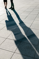 Large Shadow of a Business Couple in the Street