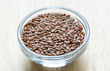 Flax seeds isolated in the glass bowl