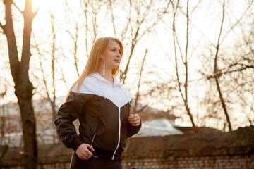 Morning jogging in sunlight