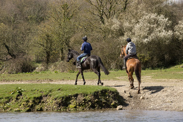 Horse riders on the Ogmore River in South Wales UK