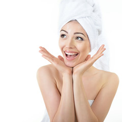Fresh clean beautiful smiling woman wrapped in bath towels. Heal