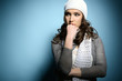 Cute attractive fashion young girl in warm clothes looking left