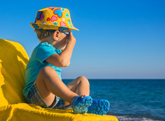 Small child looks at the sea