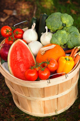 Basket with organic fruits and vegetables.
