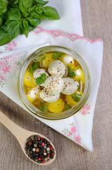 Baby mozzarella in oil with spices