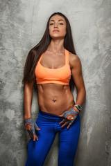 Attractive fitness woman posing in studio