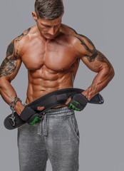 Muscular guy holding power waist