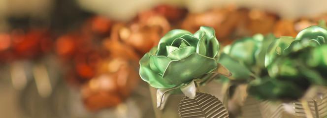 A Green Metal Rose Among Dozens More