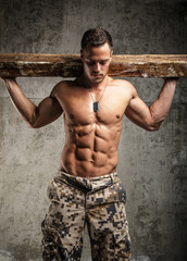 Awesome army man with naked torso