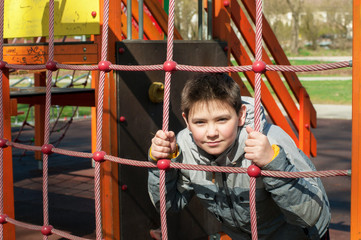 boy on the playground in the park