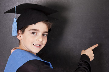 child with graduation gown isolated