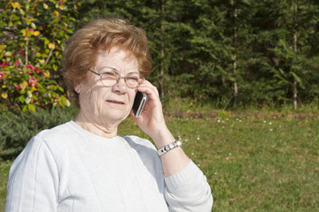 senior woman with phone outdoors