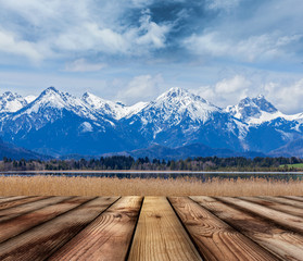 Wooden planks floor with Bavarian Alps landscape