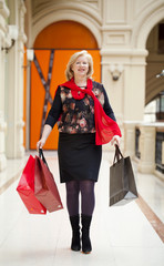 Mature happy woman with shopping bags