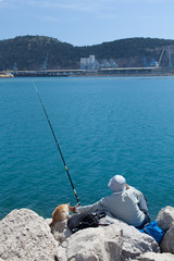 fisherman in the company of a cat
