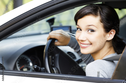 Pretty girl in a car - 81634931