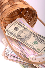 european money on wooden basket, hryvnia, dollars, euro