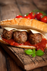 Sandwich with meatballs on rustic background