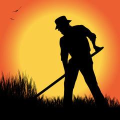 silhouette di contadino in un campo di grano