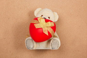 Teddy bear with a heart on vintage background