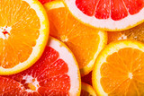 Fototapety grapefruits  and oranges background