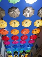 colours umbrella in blue sky