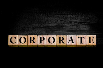 Word CORPORATE isolated on black background