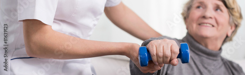 Elder woman training with dumbbell - 81639123