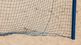 Football summer sport. goal net on a sandy beach poster
