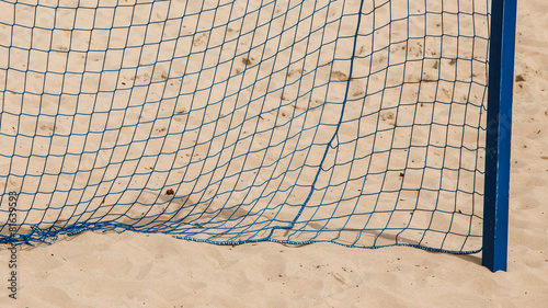 poster of Football summer sport. goal net on a sandy beach