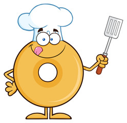 Chef Donut Cartoon Character Holding A Slotted Spatula