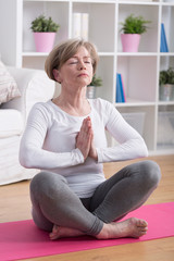 Lady meditating in lotus position