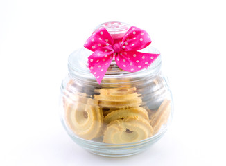 Glass jar with cookies isolate on white background