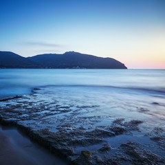 Baratti bay, headland hill, rocks and sea on sunset. Tuscany, It