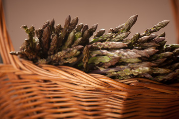 Fresh wild asparagus on a basket ready to be cooked
