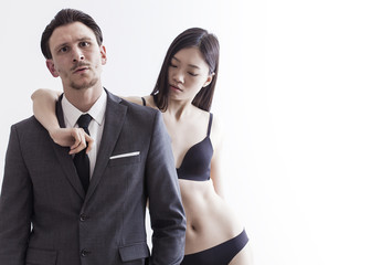 Businessman and beautiful chinese model couple