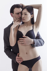 Businessman and chinese model portrait