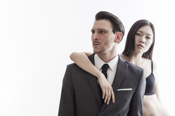 Businessman looking aside and chinese model