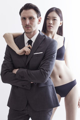 Businessman portrait with beautiful chinese model