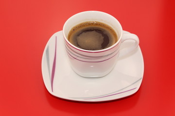 Isolated traditional Turkish coffee on a red background